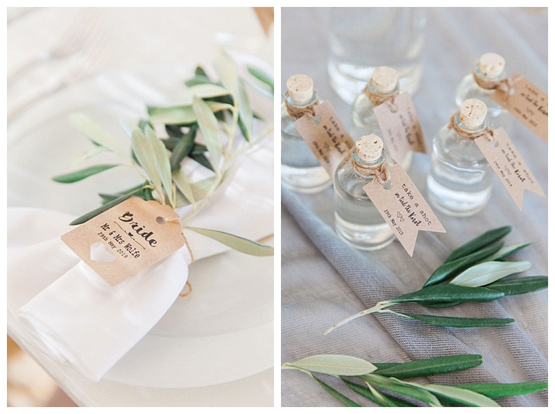 wedding napkin tied with olive sprig and ouzo miniature favour