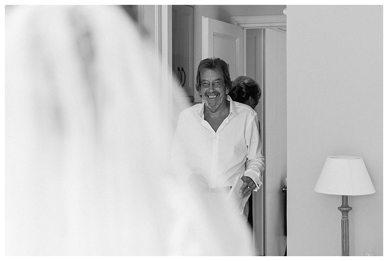 black and white image of father seeing daughter dressed as bride for first time