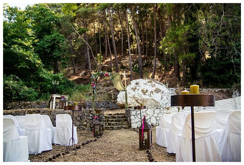 woodland wedding ceremony set up with flower arch