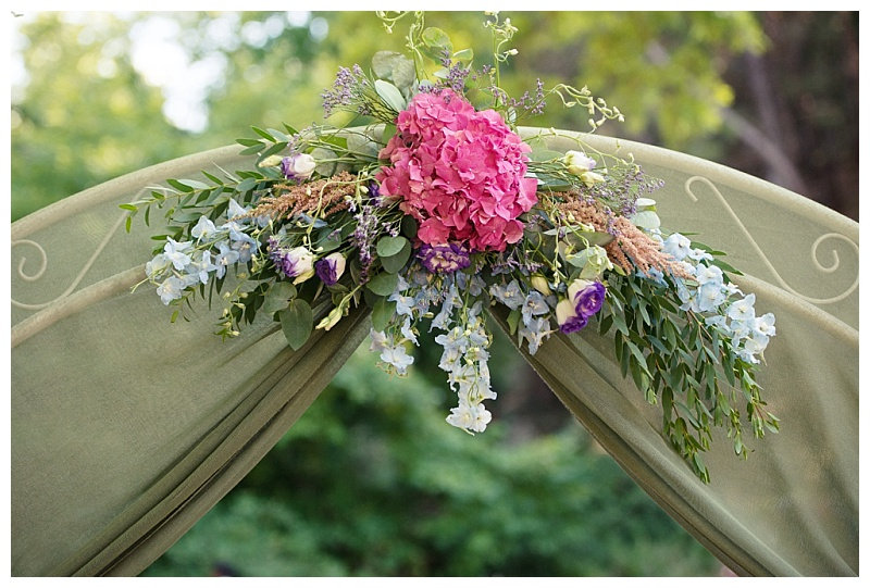 wedding arch centrepiece with pink and purple flowers