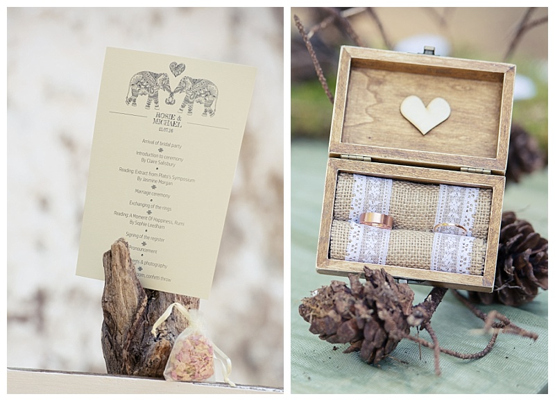 order of service with elephant detail and wooden ring box with fir cones