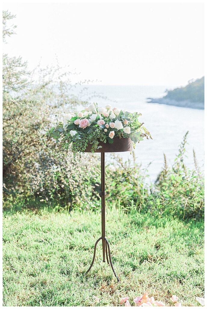 metal floral stand with pink and green flowers on lawn