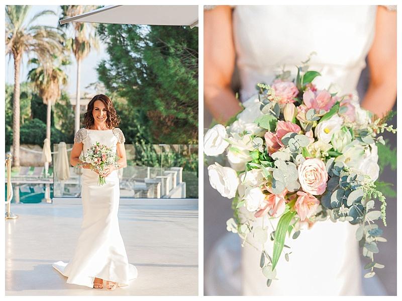 bride walking beside pool carrying bouquet