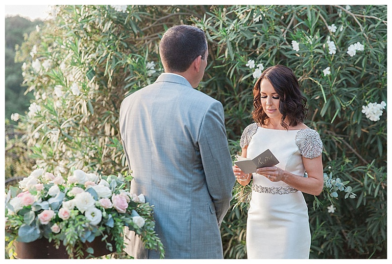 bride reading vow book at wedding ceremony