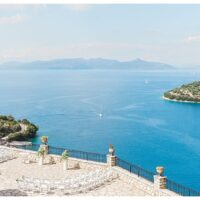 aerial view of terrace overlooking the sea set for wedding ceremony