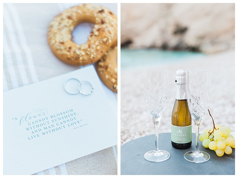 mini champagne on slate with crystal glasses with beach in background