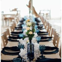 long micro wedding table with blue and copper decor details
