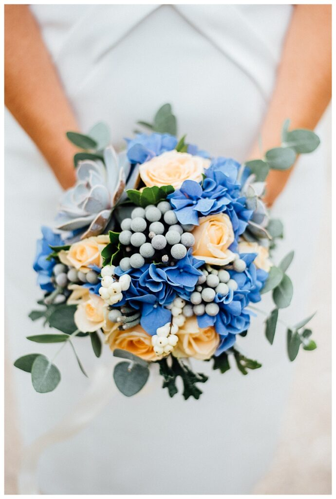 bride bouquet with blue hydragnea, grey brunia berries, peach roses and eucalyptus