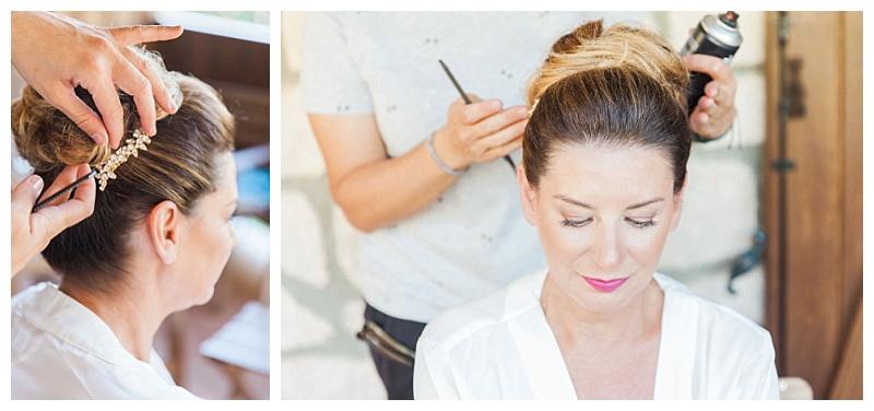Hair sylist finishing bridal bun up do