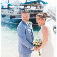 Happy bride and groom at ceremony after postponing wedding in Greece