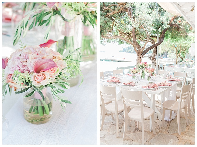 Pink calla lilies in vases on wedding table in Greece